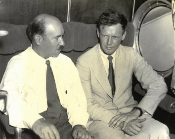 1934, July 3. BA. Bridgeport, Connecticut. LINDBERGH PILOTS GIANT S-42 IN TEST.  Colonel Charles A. Lindbergh (right), designer of the giant 18-ton transport plane built for the Pan American Airways primarily for Trans-Atlantic service, the S-42, shown in the plane before its test flight at Bridgeport, Conn., July 3. AP Photo (Front)