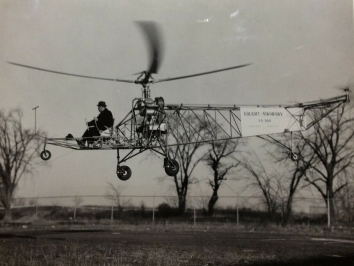 1939, September 14. DA. Stratford, Connecticut. The first flight of the VS-300, the world's first practical helicopter, designed by Igor Sikorsky and built by the Vought-Sikorsky Aircraft Division of the United Aircraft Corporation. This was the first helicopter to incorporate a single main rotor and tail rotor design. Photo by Sikorsky Aircraft. Division of the United Aircraft Corporation (Back)