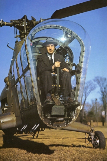 1945. AA. Igor Sikorsky in the cockpit of a Sikorsky S-48 (R-5) helicopter.